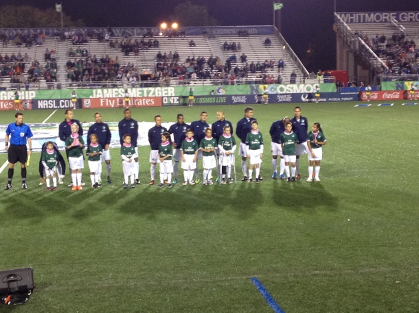 New York Cosmos Line Up With The Youth Before The Match
