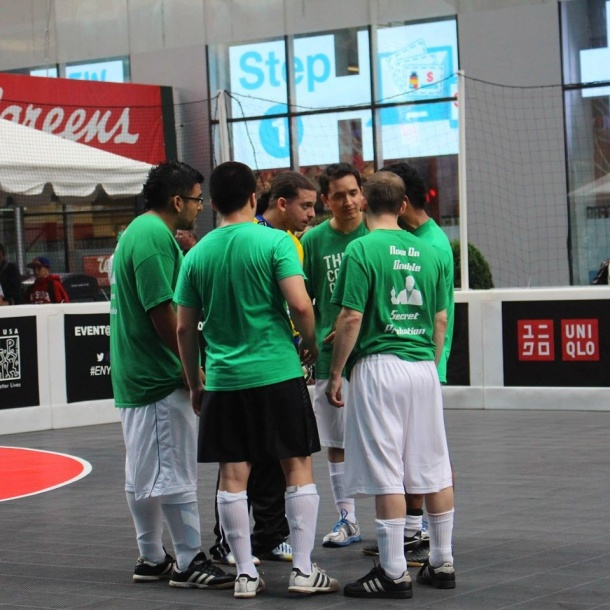 Members of The a Five a points huddle around prior to one of their matches on Sunday Photo Credit - Janine Odell