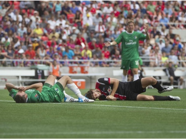 Hunter Gorskie lays hurt against Ottawa. The Cosmos defense has seen several key injuries this year.