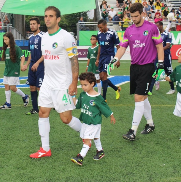 Carlos Mendes & Jimmy Maurer walkout out with young fans prior to Saturday's match. Photo credit - Eytan Calderon