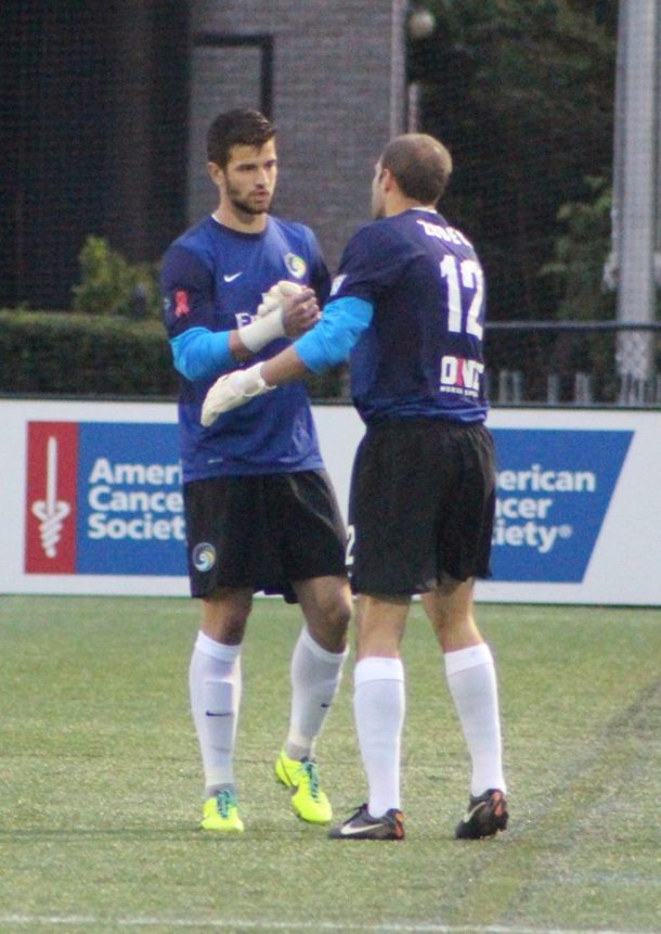Jimmy Maurer encourages Kyle Zobeck after being sent off with a red card in the 5th minute. Photo Credit - Kathleen Vera