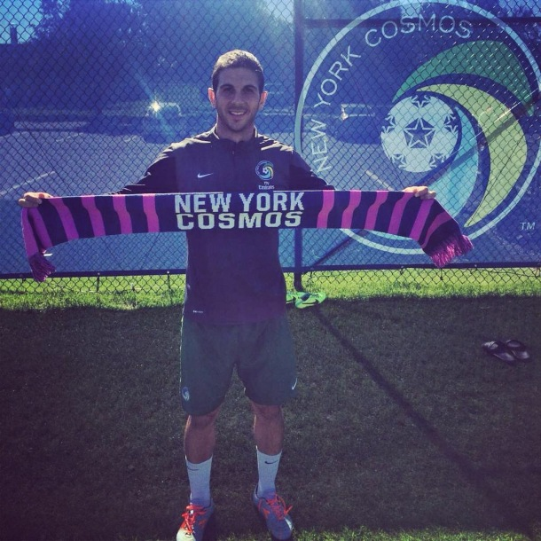 Carlos Mendes Showing Off The Scarf To Be Given Out tonight as part of Breast Cancer Awareness Night! Photo Credit - NY Cosmos