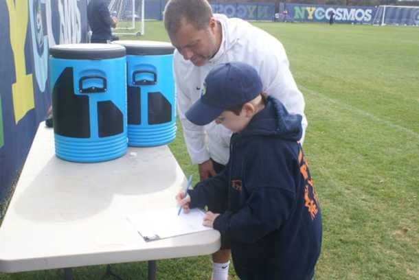 Last fall, a young Zachary Bernstein signed his one day contract with the NY Cosmos. Photo Credit - NY Cosmos