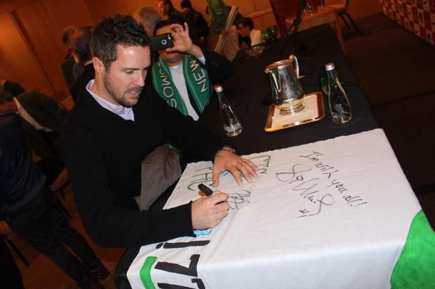 Hunter Freeman signing the banner. Photo Credit - Eytan Calderon