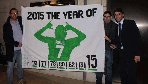 Raul poses with the banner that was created for him. The theme hopes that #7 will produce the club's 7th championship.  Photo Credit - Eytan Calderon