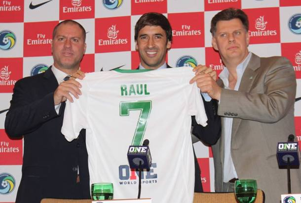Flanked By His Head Coach Gio Savarese On left and the Chairman of the Cosmos Seamus Obrien on the right, Raul holds up his new jersey!  Photo Credit - Eytan Calderon