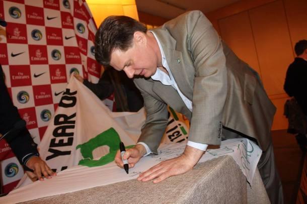 Cosmos Chairman Seamus O'brien signs the banner as well. Photo Credit - Eytan Calderon
